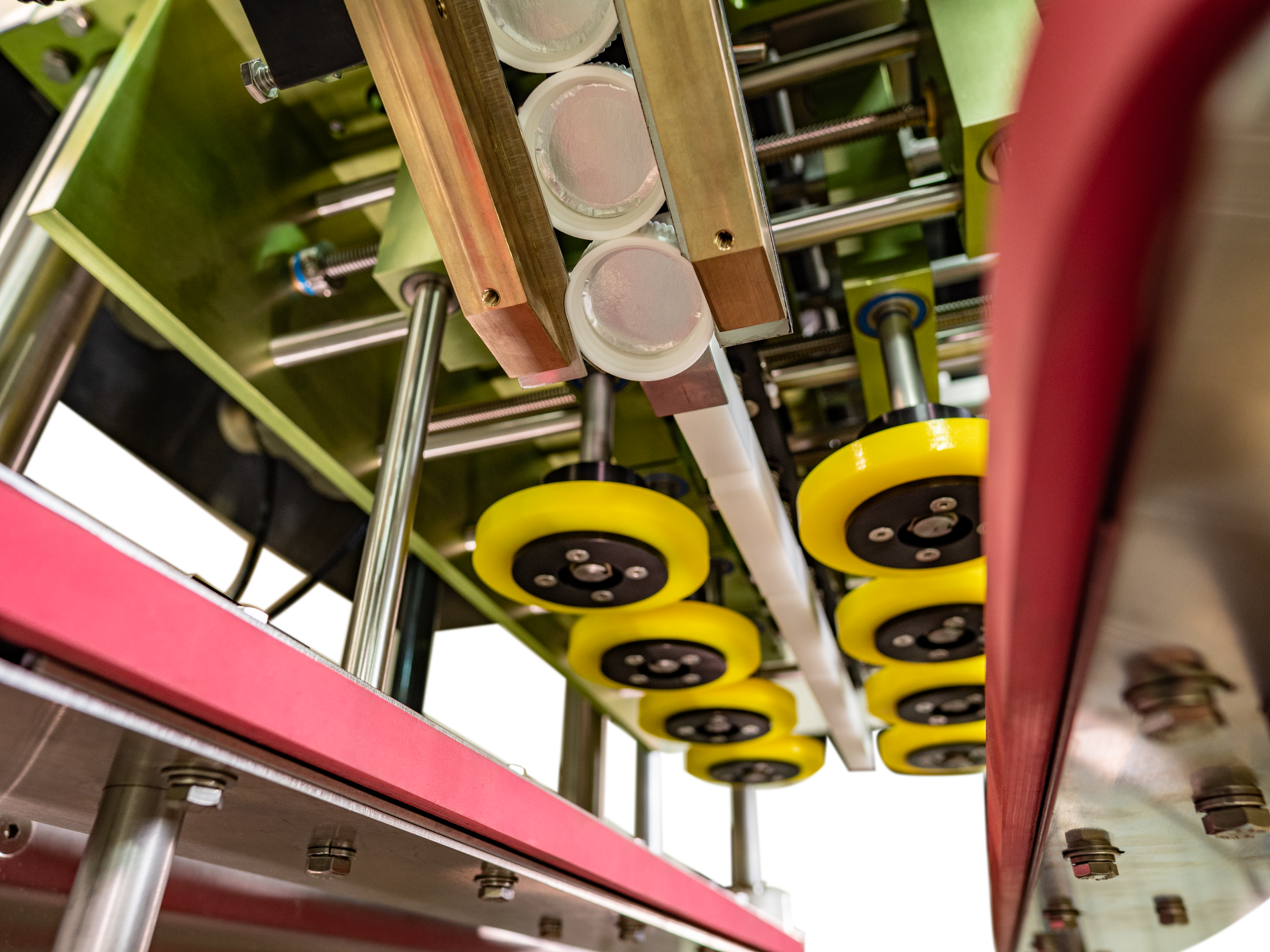 The modular control hub is suspended above the conveyor for easy access and can be easily moved based on operator preference.